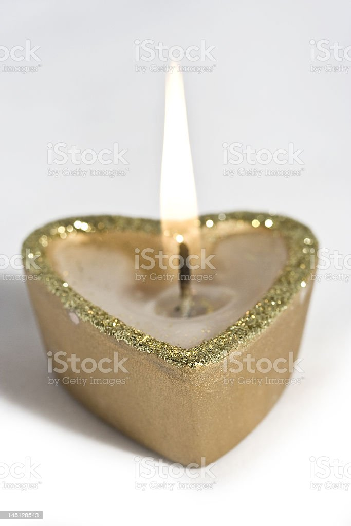 candles shaped heart in gold stock photo