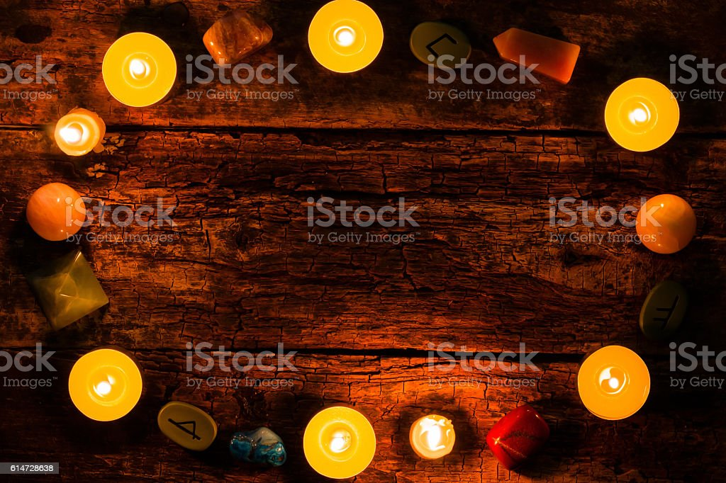 candles, stones for divination and runes on wooden background mockup – Foto