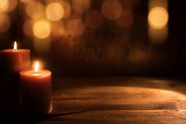 candles with golden bokeh - candle stock pictures, royalty-free photos & images