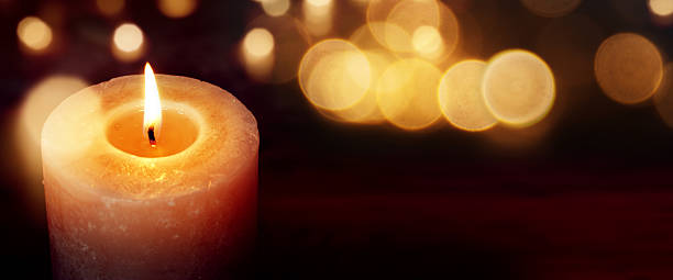 Candles with golden lights - Photo