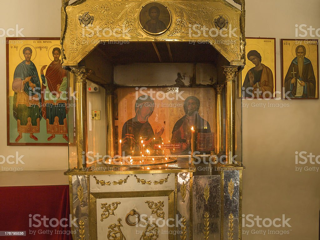 Candlestick and icons in St. Neofitas monastery. Cyprus royalty-free stock photo