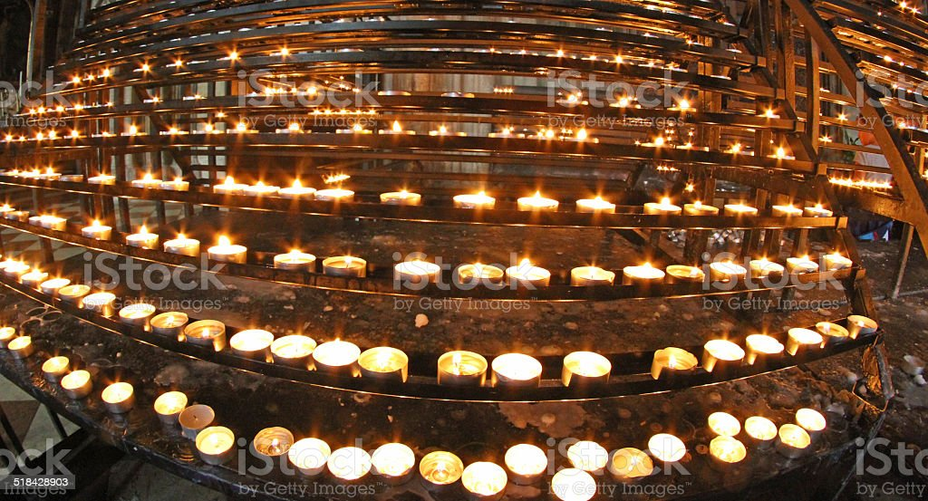 Candlestick In Church With Many Wax Candles Lit By Faithful