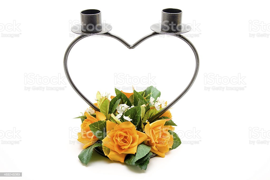 Candlestick in heart form and blossoms stock photo