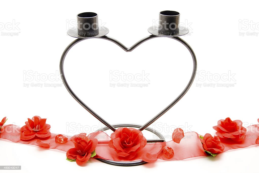 Candlestick in heart form with loop stock photo
