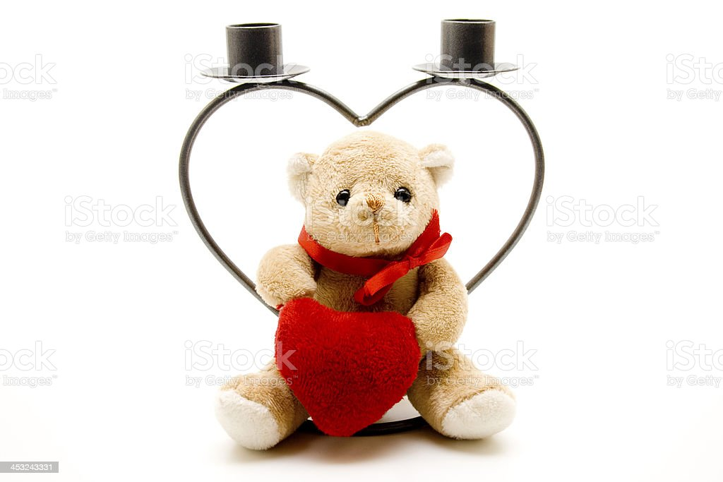 Candlestick in heart form with plush bear stock photo