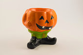 istock candlesticks decorated for Halloween in the form of pumpkins 1226645028
