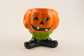 istock candlesticks decorated for Halloween in the form of pumpkins 1226645030