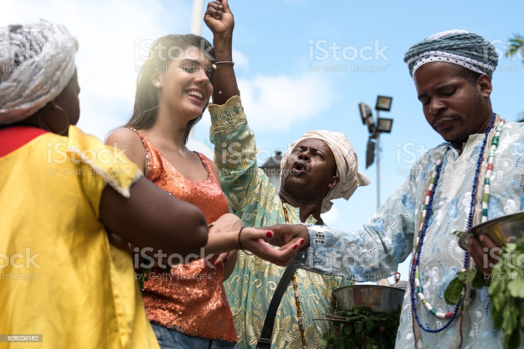 Candomble group blessing a woman stock photo