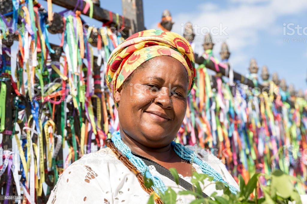 Candomble priestess wearing traditional clothes at Bonfim Church in Salvador, Bahia, Brazil stock photo
