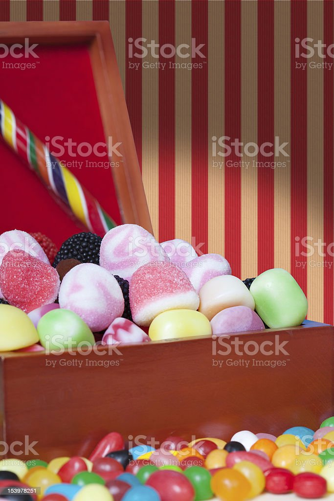 Candy assortment in a wooden box royalty-free stock photo