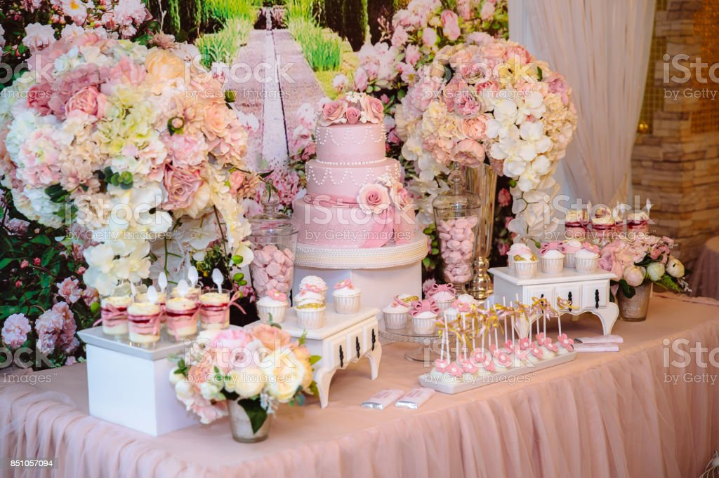 Candy bar and wedding cake. Table with sweets, buffet with cupcakes, candies, dessert. stock photo