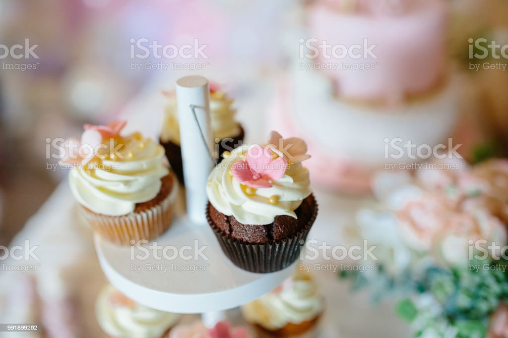 Candy Bar Decorated With Sweets Cupcakes And Cake For Birthday Party