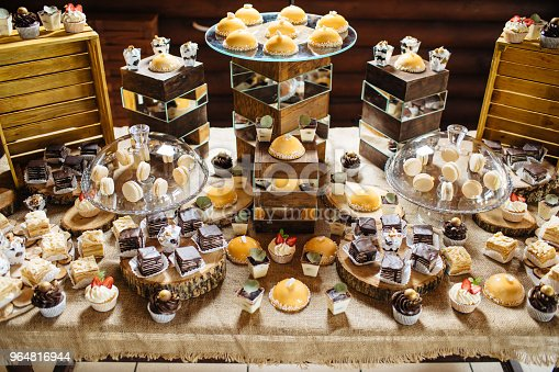 Candy Bar Table With Different Sweets For Party Stock Photo & More Pictures of Baked