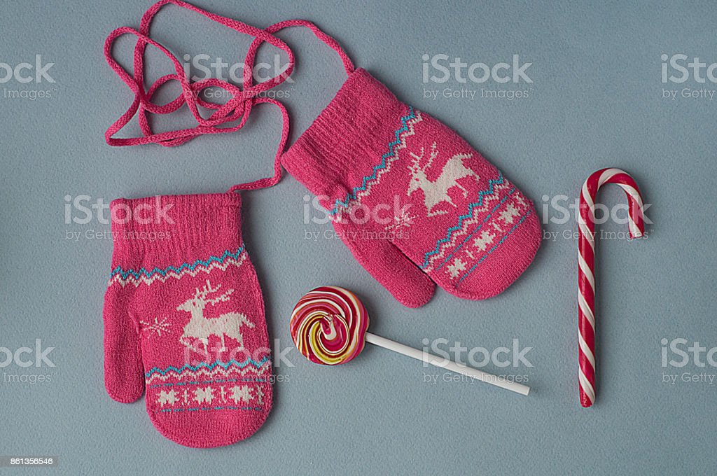 Candy cane and mittens stock photo