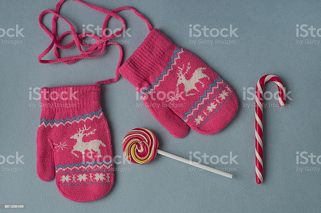 Candy cane and mittens'n'n stock photo