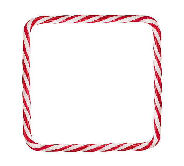 Candy cane frame Close up of candy cane frame isolated on white background with copy space candy cane stock pictures, royalty-free photos & images