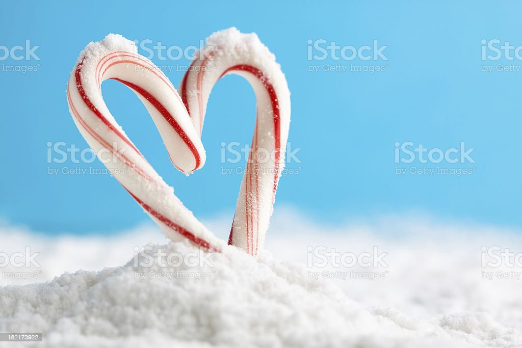 candy cane heart on snow stock photo