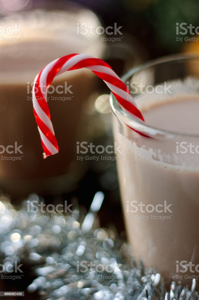 Candy cane in hot christmas drink. stock photo