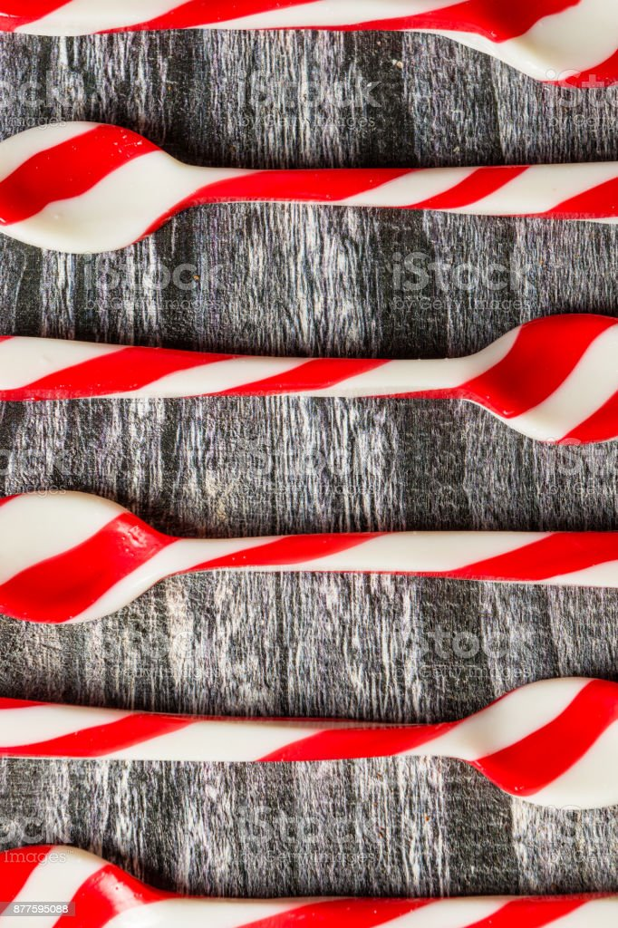 Candy cane spoons on wood stock photo