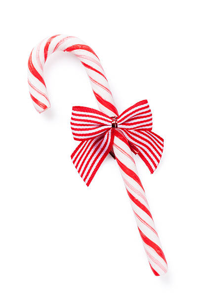 Candy cane with bow Candy cane with bow. Isolated on white background candy cane stock pictures, royalty-free photos & images