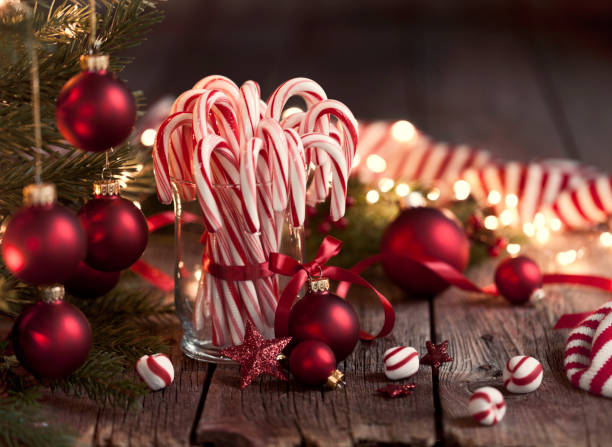 Candy Canes and Bright Christmas Lights Candy Canes, candles and bright Christmas lights candy cane stock pictures, royalty-free photos & images