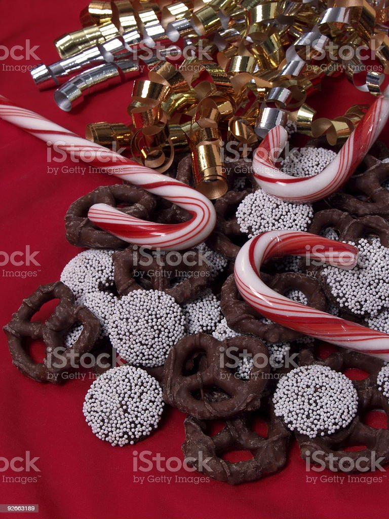 Candy Canes, Chocolate Pretzels and Nonpareils on Red stock photo