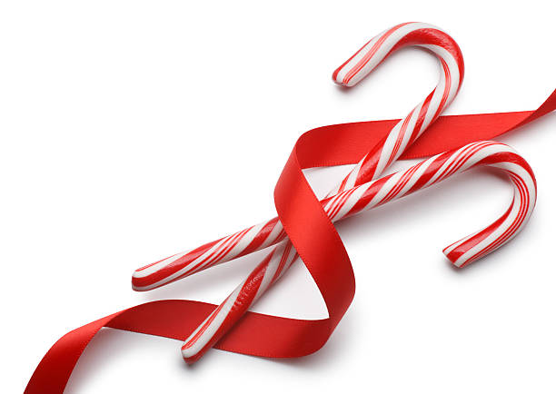 Candy Canes Candy canes with red ribbon on white with soft shadow. candy cane stock pictures, royalty-free photos & images