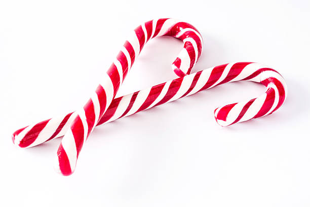 Candy canes Candy canes isolated on white background candy cane stock pictures, royalty-free photos & images