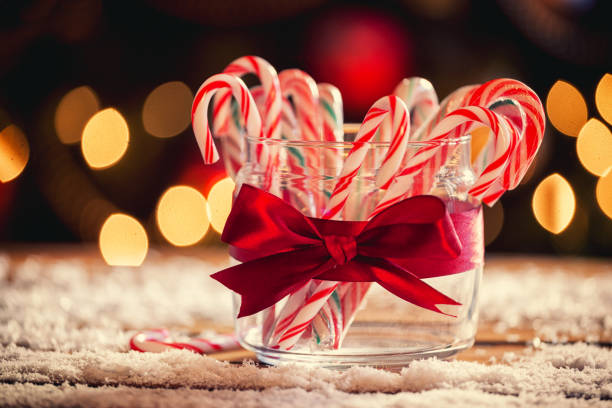 Candy Canes Candy canes in front of Christmas tree candy cane stock pictures, royalty-free photos & images