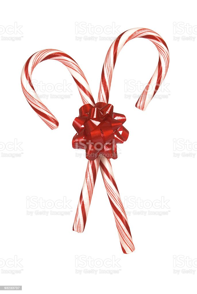 Candy canes tied together by a red bow royalty-free stock photo