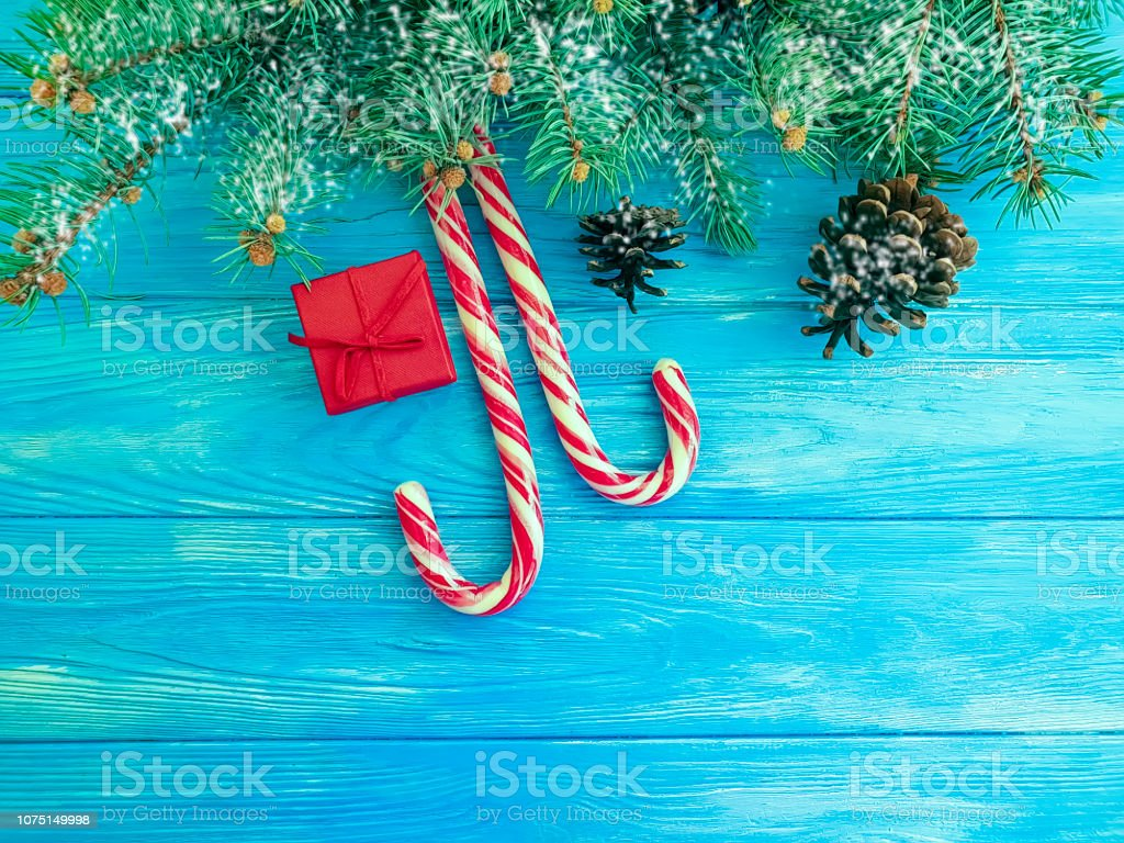 Candy Christmas Tree Branch Gift Box On A Blue Wooden Background Stock Photo Download Image Now Istock