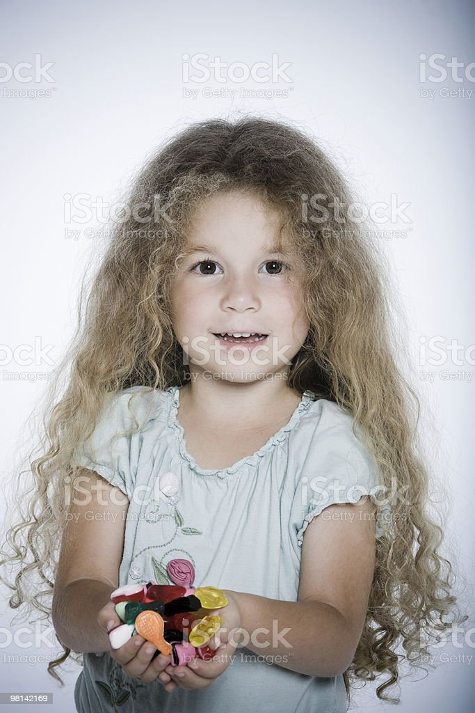 candy handful little girl royalty-free stock photo