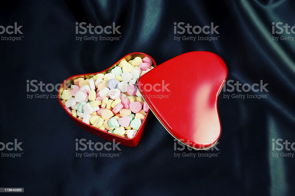 Candy in Red Heart Tin on Black Background Stylized royalty-free stock photo