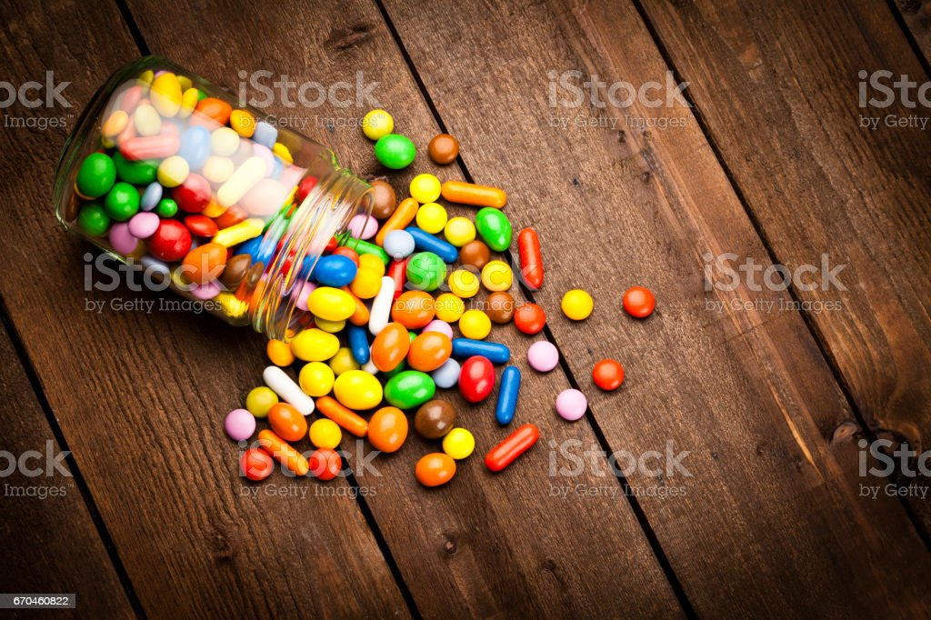 Candy jar on wooden table stock photo