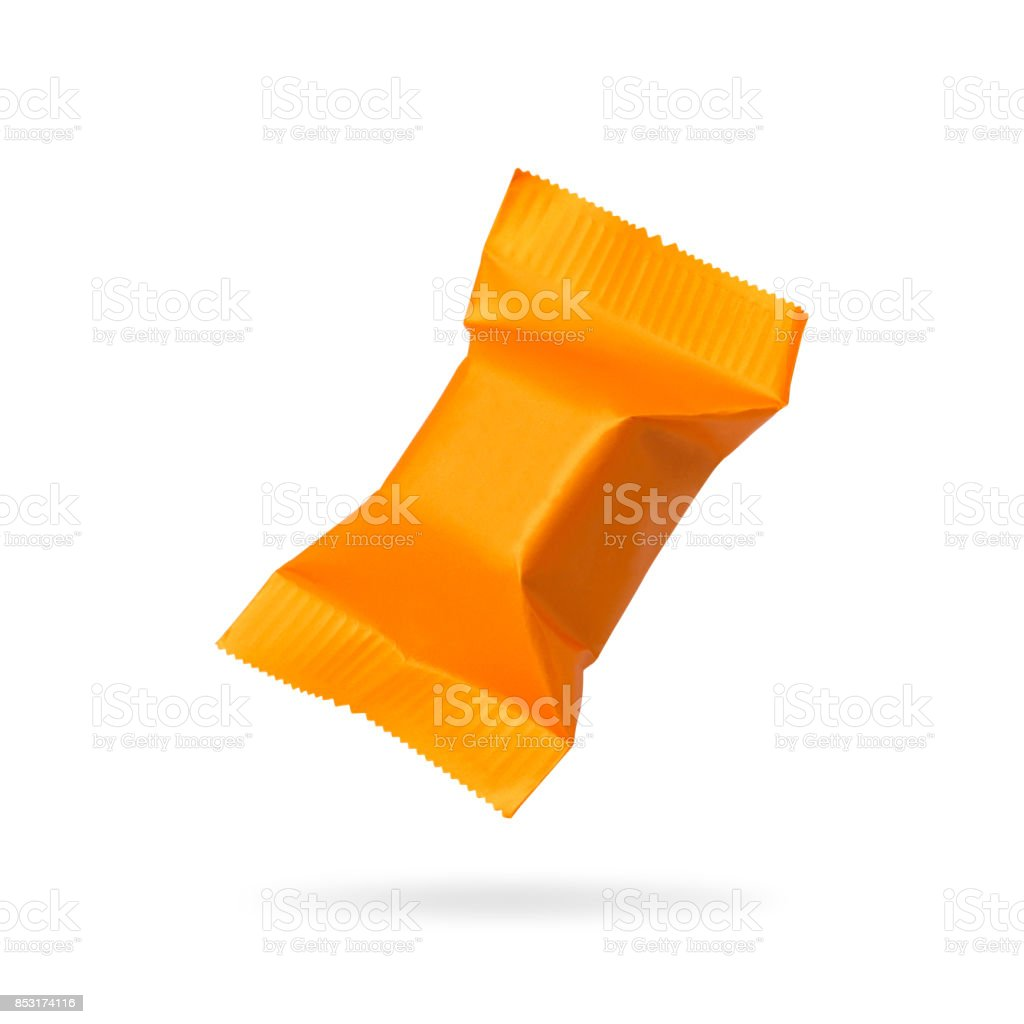 Candy packaging isolated on white background. Orange toffees product for your design. Clipping paths object. stock photo