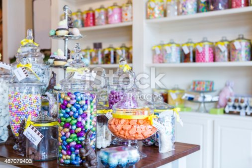 Jars filled with different candies at the boutique candy store.