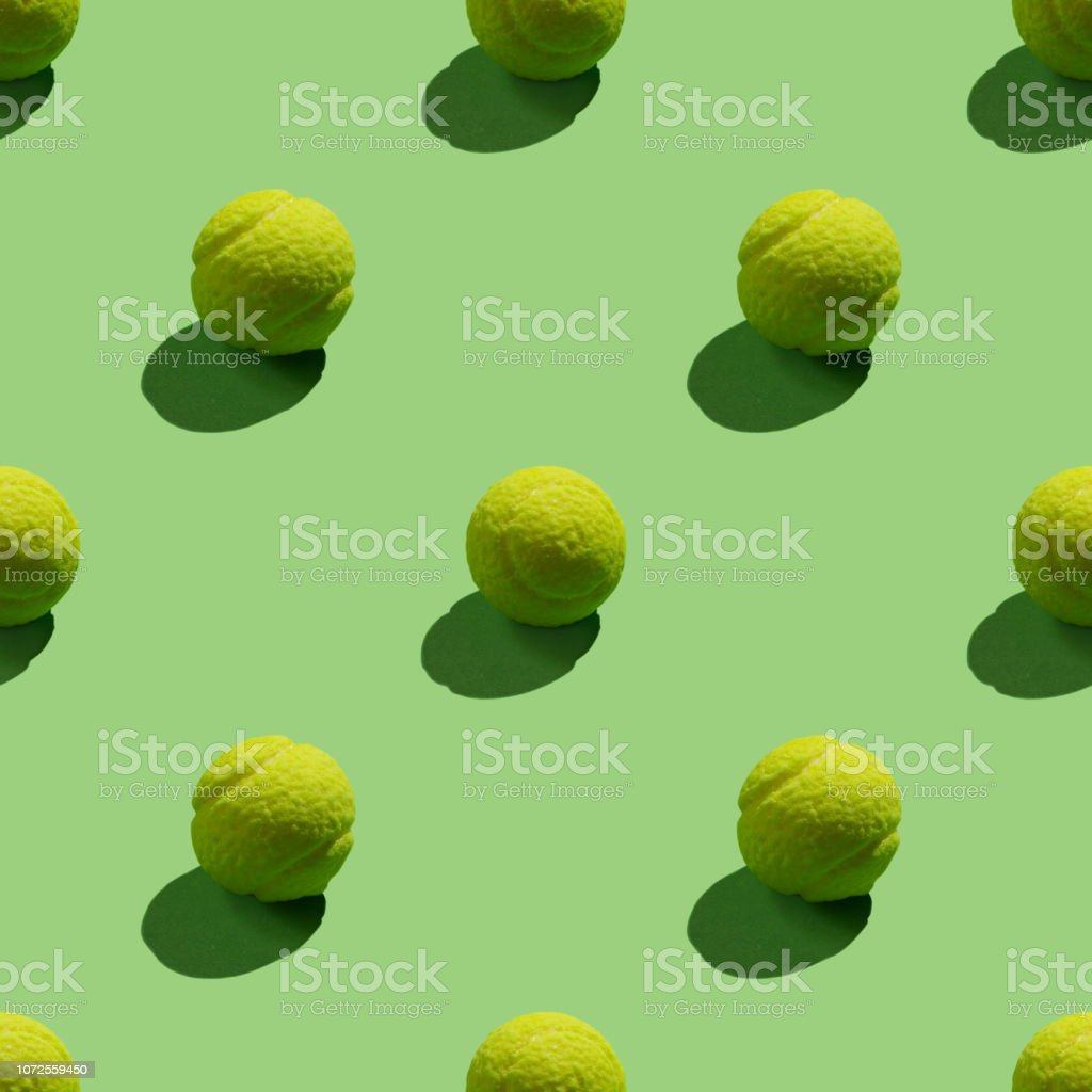 Seamless bright background of green and-tennis ball.