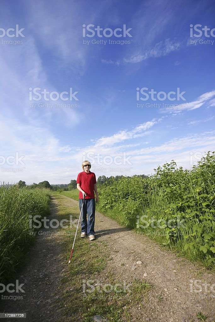 Cane Mobility on a Country Road stock photo