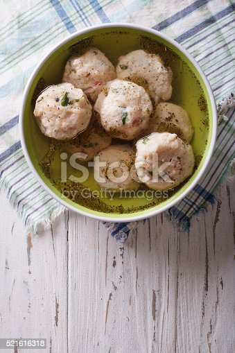 istock canederli soup on the table. vertical top view 521616318