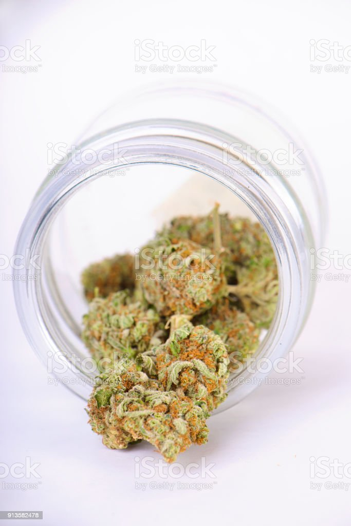 Cannabis Buds On Glass Jar Isolated On White Stock Photo