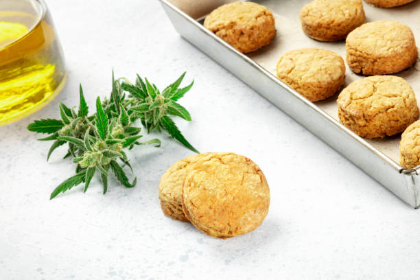 Cannabis butter cookies with marijuana buds and cannaoil, homemade healthy biscuits, close-up shot stock photo