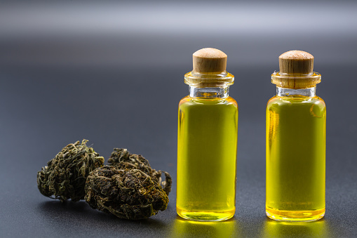 1177762728 istock photo cannabis CBD oil hemp products, cannabis oil extracts in jars,  patient medical marijuana and oil.  alternative remedy or medication, medicine concept 1203343492