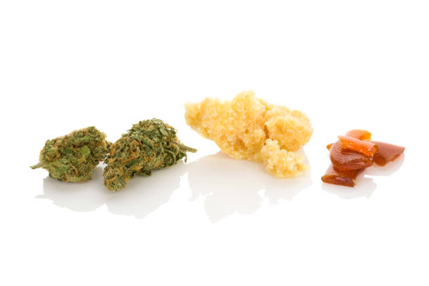 Cannabis concentrate shatter, bud and crumble. stock photo