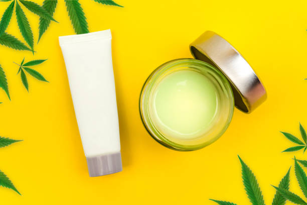CBD cannabis gel and lotion with cannabis leafs stock photo