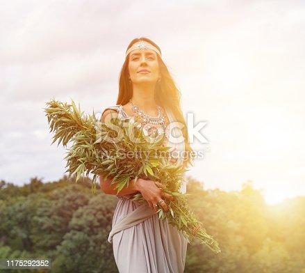 istock Cannabis Goddess holding bundle of cannabis plants 1175292352