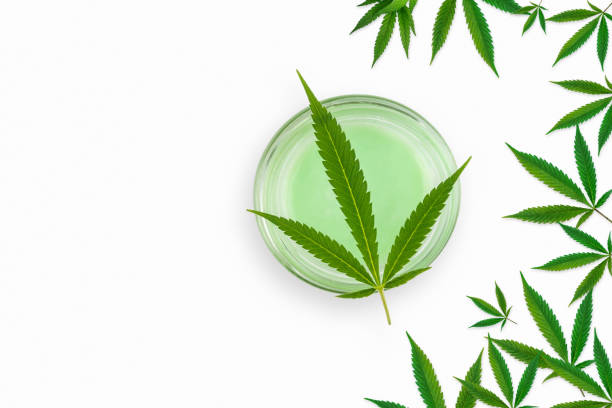 CBD Cannabis Hemp topical cream and balm with cannabis leaf isolated stock photo