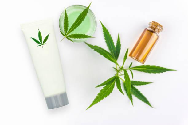 CBD Cannabis Hemp topical cream and oil balm with cannabis leaf stock photo