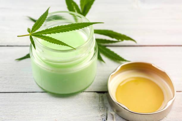 CBD Cannabis Hemp topical cream balm with cannabis leafs stock photo