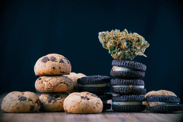 Cannabis nug over infused chocolate chips cookies - medical marijuana edibles concept stock photo