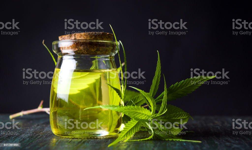 Cannabis oil and marijuana leaves stock photo